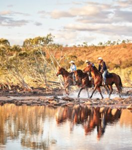 3 outback horse riders on a tour